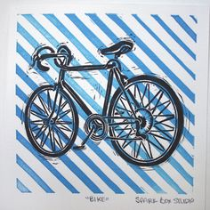 Lino print of a bike - think about printing onto patterned backgrounds?
