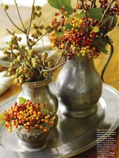 Fall foliage mixed with tarnished pewter perfect combo for tablescape from Good Housekeeping