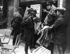 """SA Members Hang Boycott Posters on a Jewish Shop in Munich (April 1, 1933) With the April 1st """"Jewish boycott"""", Hitler aimed to placate impatient SA men and party members. At the same time, he also used the boycott to signal that anti-Semitic actions should (and would) be organized and directed from a central point. This was the first step toward legalized state persecution of Jews in the Third Reich."""