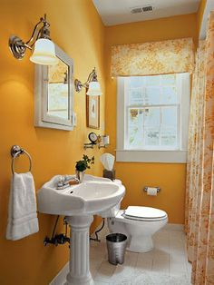 wall sconces break up this small yellow bathroom... Small Bathroom Chic: Sophisticated Lighting from Bathroom Bliss by Rotator Rod