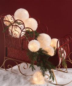 RAZ Red Metal Sleigh filled with Lighted Snowball Garland....you could also fill with pinecones and battery lights))