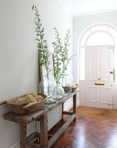 Rustic table entryway | Wall Heater Covers That Camouflage Ugly Radiators | Apartment Therapy