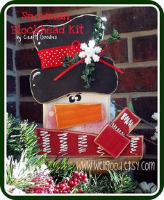 Change up his colors to blue and purple and BAM! Another perfect winter friend...SNOWMAN Blockhead Kit by wellgood on Etsy, $5.00