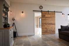 Engineered reclaimed pine door with industrial sliding mechanism - The Main Company Blue Kitchen Interior, Kitchen Room Design, Modern Kitchen Design, Home Decor Kitchen, Navy Kitchen, Kitchen Ideas, Open Plan Kitchen Dining Living, Living Room Kitchen, House Extension Plans