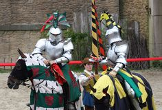 Medieval Knights dressed for pageanty and combat re-enactment in the medieval section of the Puy du Fou theme park.