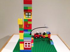 High rise with gas station. Rescuing a panda and dinosaur from a fire by Little Kun. Lego Duplo, Gas Station, Panda, Kids Rugs, Fire, Toys, Projects, Home Decor, Lego Duplo Table