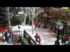 Christmas Village Displays - with Lemax houses, Department 56 models, trees, snowmen and figurines - YouTube
