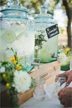 Woman Cave - Ice Cold Detoxing Lemon or Lime Water in Drink Dispensers - Balance and Harmonize Your Woman Cave at the link.