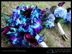 Blue and purple brides bouquet with peacock feather
