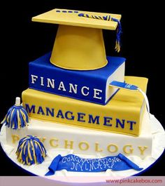 Stacked Books with Graduation Cap Cake.   Change the books based on the graduate's field of interest.