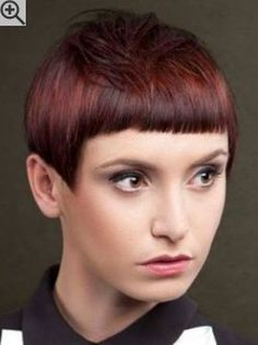 Pixie cut with very short bangs and smooth styling. With a straight cutting line above the ears.                                                                                                                                                                                 More