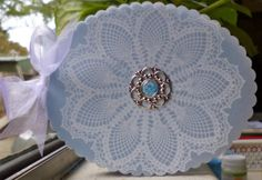 Stampin' Up!, Oval Framelits, Hello Doily stamp, vellum, white craft ink, Pacific Point card stock, designer brad.