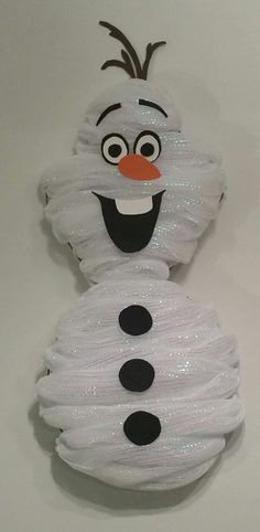 Deco-mesh wreath, made in the likeness of the lovable Olaf! Its 8 inches wide, and 26 inches tall. Will easily fit in any doorway, or would look