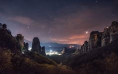 Night at the Meteora monasteries with the lights of the town of Kalambaka in the valley, by Krasi St M (Greece)