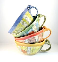 Four ceramic soup mugs or cappucino cups IN STOCK - latte cups - soup bowls with handles - rainbow colors carved woodland design. $135.00, via Etsy.