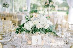 Summer & John's blush, ivory and gold inspired Lowndes Grove Plantation wedding photos. Planned and Coordinated by A Charleston Bride and wedding photos by Aaron and Jillian Photography. Lowndes Grove tent draped in ivory linen, gold chiavari chairs, custom linens, floral chandeliers.