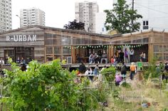 Unité d'agriculture urbaine et citoyenne – Colombes, Ile-de-France. AgroCité – an urban agriculture hub which consists of a micro-experimental farm, community gardens, educational and cultural spaces and devices for energy production, composting and rainwater recycling.