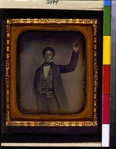 [Edward J. Roye, three-quarter length portrait, standing, with hand raised]