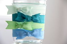 A much cuter way to finish foldover elastic hair ties! Love this darling idea!