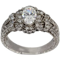 Antique Filigree Oval Diamond Engagement Mounting -  This engagement mounting can hold between a 0.75ct up to a 1.00ct oval center diamond.     This ring has brilliantround diamonds whichenhance the oval cutcenter diamond.         The milgrain and engraving give this ring thedistinct appearance of the antique style  .     At Dacarli emphasis is placed on design, quality, and modern, high-tech manufacturing techniques.   The characteristics of these rings are milgrain...