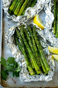 This recipe for grilled asparagus in foil is tender fresh asparagus stalks cooked in foil packets with butter, seasonings and herbs. Throw these foil packs on the grill or bake in the oven for an easy side dish! Grill Asparagus In Foil, Grilled Asparagus Recipes, Baked Asparagus, How To Cook Asparagus, Fresh Asparagus, Grilled Veggies, Grilled Recipes, Asparagus On The Bbq, Vegetables On The Grill