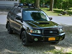 """2004 Java Black Pearl Subaru Forester XT with blacked out grill, black plastidipped rims, curt roof basket and 1"""" lift www.turboforester.org and www.snailmafia.com"""