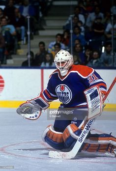 goalie-grant-fuhr-of-the-edmonton-oilers-looks-to-make-the-save-an-picture-id147492632 (693×1024) Hockey Goalie, Ice Hockey, Goalie Mask, Edmonton Oilers, Nhl, Athlete, Sports, Masks, Photos