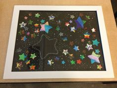 3rd Grade class art auction piece for school auction. Watercolored stars by the kids with a quote around the main star. Good end of the year art project for kids.