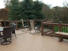 "Looking to upgrade your existing deck? Check out our custom deck railing options to put a little extra ""oomph"" into your outdoor space! We also offer free estimates, so contact Decks R Us today to get started! #deckrailings #deckdesigns #deckideas"