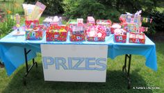 At each game, the kids could earn tickets based on how they played.  Then they got to redeem them at the prize table for all kinds of cool p...