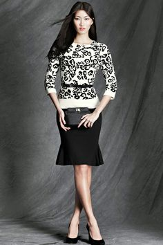 """Mad Men"""" gets modernized with this thin sweater and fitted skirt. Add a belt to show off that tiny waist—and your hourglass shape—for a look Joan Holloway would definitely approve of."""