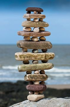 Sandstone Stack, by Richard Shilling who goes out looking for things to make into sculptures which he photographs. On Flickr he posts the best, along with the story of his day. #photography, #narrative, #rocks, #coast LOOKS LIKE INUKSUIT ART.