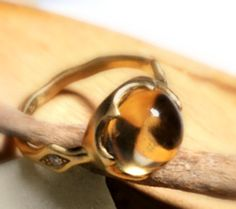Woman gold ring with daimonds and citrine. Gold ring by shmukies