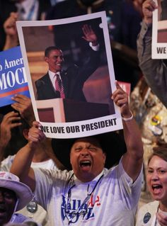 Gus Mansour holds up a poster of Democratic presidential candidate, U.S. President Barack Obama during day two of the Democratic National Convention at Time Warner Cable Arena on September 5, 2012 in Charlotte, North Carolina. The DNC that will run through September 7, will nominate U.S. President Barack Obama as the Democratic presidential candidate. (Photo by Win McNamee/Getty Images)