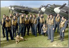 Crews of No 137 Squadron RAF pose with a mascot in front of their Whirlwind Mk I fighter bombers at RAF Manston, Kent.  March 5 1943.