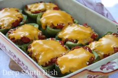 Creole Stuffed Bell Peppers - Sweet bell peppers stuffed with a mixture of ground beef, Italian sausage, rice and a Creole tomato sauce, topped with cheddar cheese or thin slices of Velveeta.