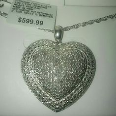 BLING BLING 2CT GENUINE DIAMOND HEART NECKLACE NEW WOW2 CTW DIAMOND HEART NECKLACE NEW SUPER CUTE.YES THESE ARE REAL DIAMONDS. WOW WHAT A DEAL BUNDLE AND SAVE BIG. I HAVE EARRINGS.BLING Jewelry Necklaces