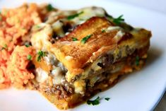 Pastelon (Puerto Rican Lasagna) | By: The Noshery | It has the perfect combo of savory and sweet, of juicy and cheesy, of wanting to lick your plate and then lick your face! It's layers of savory beef, fried sweet plantains and cheese. | From: tastykitchen.com