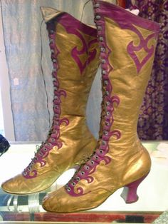 They had jazzy class back then!  gold boots with purple swirls, made by Cammeyer Shoes, 1890s