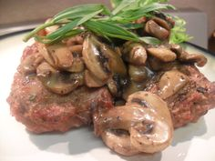 Salisbury steak with mushroom gravy. Did you know that Canadians eat more mushrooms per capita than any other nation? mmmm...mushrooms. :-)