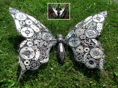 "Butterfly sculpture - art by Recycle Art in Switzerland;  39"" tall"