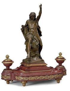 A FRENCH ORMOLU, PATINATED BRONZE AND ROUGE MARBLE FIGURAL ENCRIER, <br />LAST QUARTER 19TH CENTURY, <br />The figure of Knowledge inscribed <i>E. PICAULT</i> and stamped <i>E. COLIN & CIE/PARIS</i><br />18in. (45.5cm.) high; 15¾in. (40cm.) wide <br />