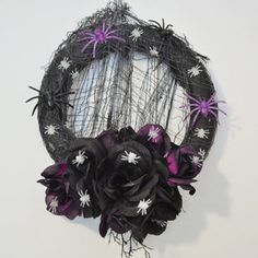 Halloween wreath black and purple flowers with glow in the dark spiders on black netting web