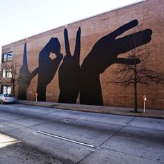 Street Art Awesome. Michael Owen develop a design of four hands spelling out the word LOVE for the project Baltimore Love Project. #Love #StreetArt #Baltimore