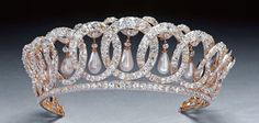 The Vladimir Tiara; made by a Russian jeweler for the Grand Duchess Vladimir. During the Russian Revolution, the Duchess moved with her family to safety while her jewels were hidden in a vault in the Vladimir Palace. The looters never found the treasure, and a member of Britain's Secret Intelligence Service friendly with the Duchess' family managed to rescue the jewels and send them back to her. The Duchess commissioned the tiara to have Oriental pearl drops.