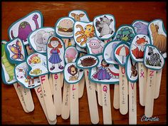 Have old workbooks? Cut the pictures out and make stick puppets for the letter sounds.