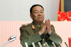 Vice Marshal Hyon Yong Chol applauds during a meeting at the April 25 House of Culture announcing No... - AP Photo/Jon Chol Jin