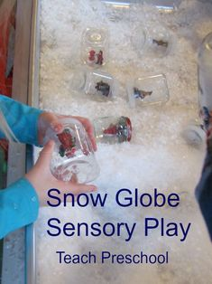 Snow Globe Sensory Box Idea - fake snow, spoons, jars of various sizes with lids and glue figurines to the lids...