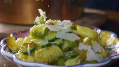 Potato gnocchi with zucchini and pecorino (gnocchi con zucchine e pecorino) | Small, young zucchini are perfect for this vegetarian dish. If you can, try to find those still attached to their golden blossoms – they will make a welcome addition to the light gnocchi sauce.