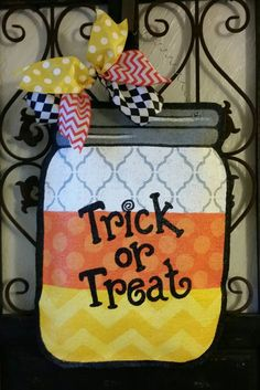 Candy corn mason jar Halloween door hanger. Hand painted burlap. Fall decoration. Wreath by ConnieRisleyCrafts on Etsy https://www.etsy.com/listing/247219396/candy-corn-mason-jar-halloween-door